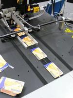 Комплекс печати кодов и наклейки защитных панелей на базе модулей Kirk-Rudy и PTS. Контроль печати и наклейки скрейч-оф полосы - LAKE Image Systems. www.tetra-pro.ru